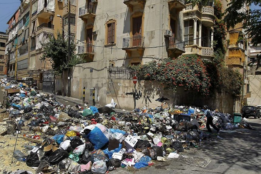 Piles of garbage left on a street in a residential area in Beirut, Lebanon.