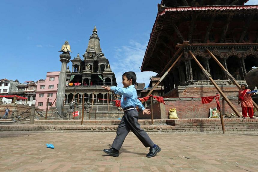 Temples in Patan Durbar Square, only three of which are still standing after two were destroyed.