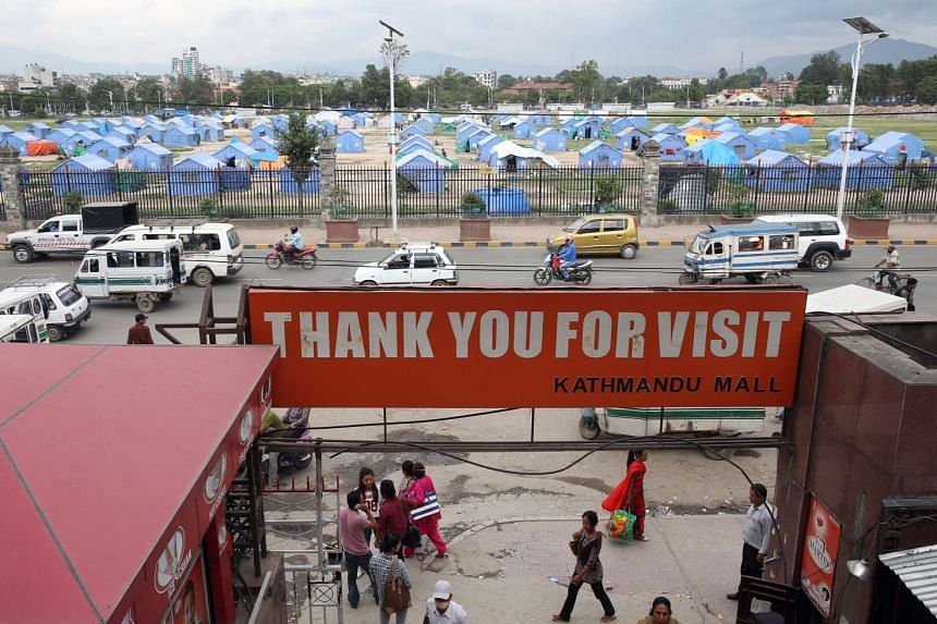 Tundikhel, where 150 to 200 blue tents serve as temporary shelters for people who have lost their homes.