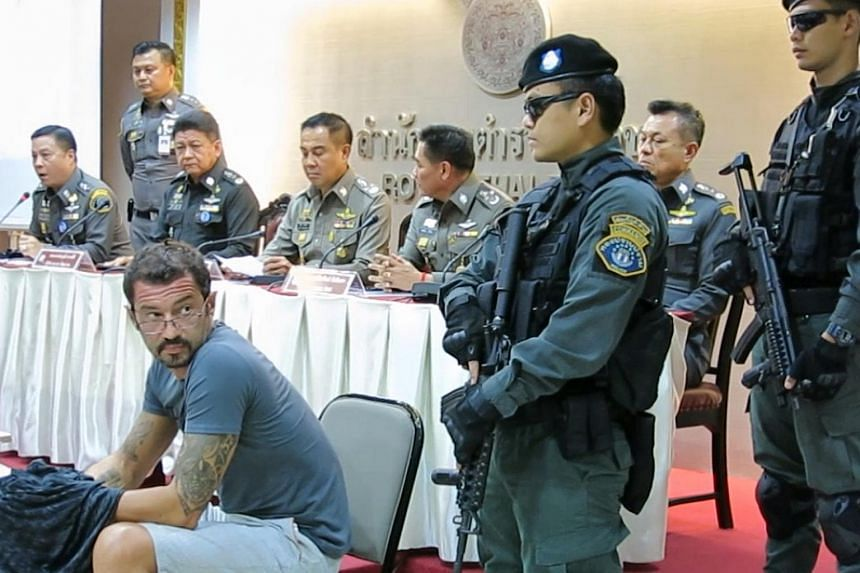 Swiss national Andre Xavier (left) Justo appearing before the media at the Royal Thai Police head office on June 22.