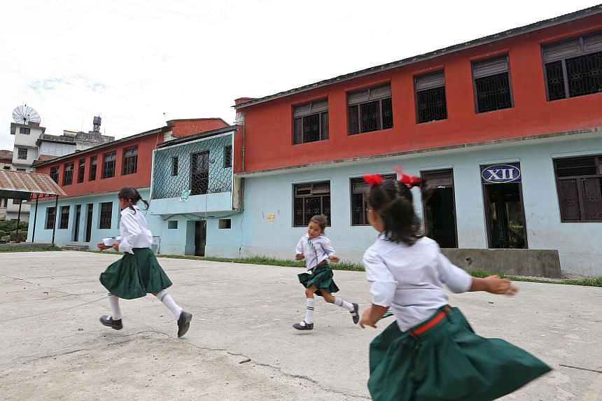 Students playing at the basketball court in Kanya Mandir Higher Secondary School in Kathmandu, which underwent retrofitting works in 2014 with the support of the National Society for Earthquake Technology-Nepal and Nanyang Technological University.