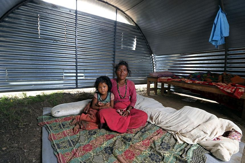 Dhan Maya Tamang, 47, and the youngest of her 5 children, Anjali Tamang, 6, in the temporary shelter in Makwanpur district, on June 20.