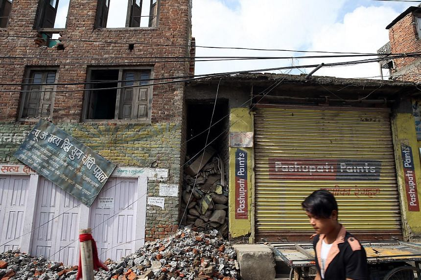 Buildings affected by the April 2015 earthquake on the outskirts of Kathmandu on June 20.