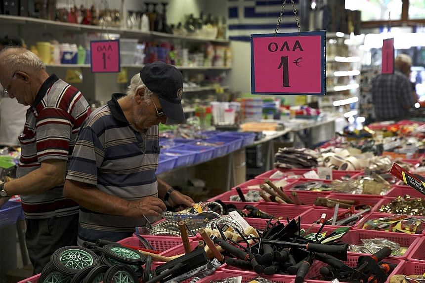 A man browsing inside a thrift shop in central Athens. Greece is seeking a three-year bailout worth up to €86 billion (S$128 billion) to avert a financial meltdown. The country had initially planned to go without fresh help from the IMF.