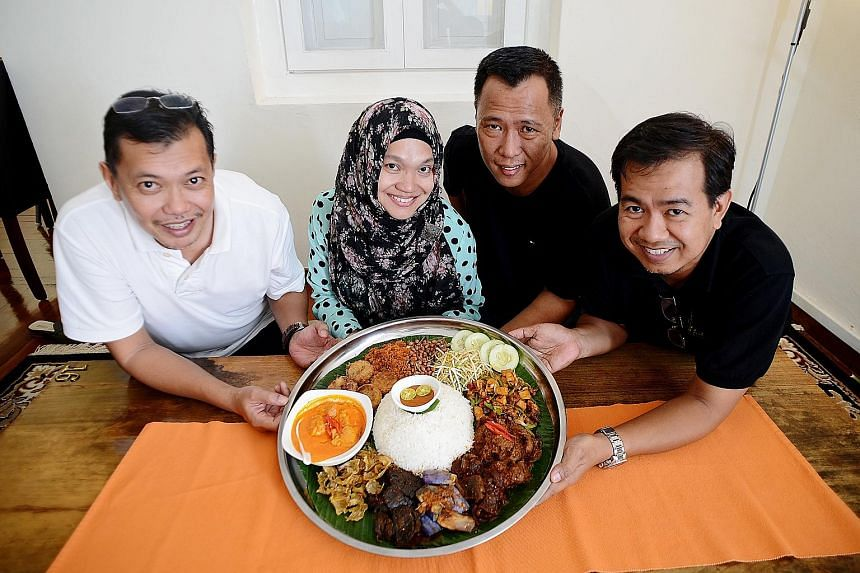 Padi@Bussorah's co-owners (from far left) Salman Abdullah, Normala Sah, Hashim Ali and Adam Malikh Zainul. The eatery sells up to 600 nasi ambeng platters a month.