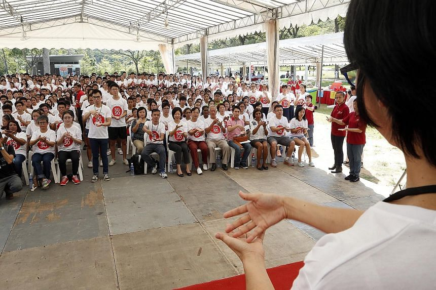 About 450 people gathered at Bishan-Ang Mo Kio Park yesterday to recite the national pledge but passers-by would have found it hard to catch the words. For the recital was done in sign language, by hearing-impaired participants, workers and volunteer