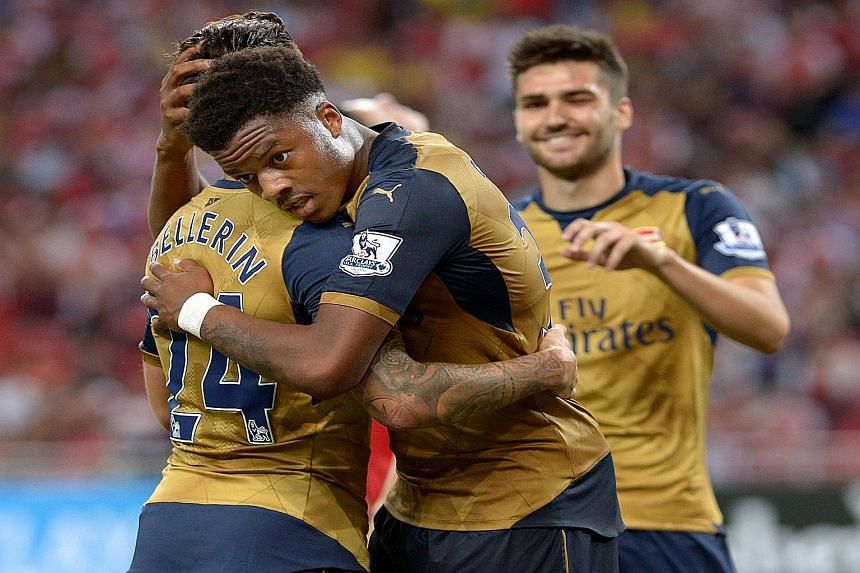 Chuba Akpom (centre), who bagged a hat-trick for Arsenal against a Singapore Selection at the recent Barclays Asia Trophy, is only 19 years old. He could turn out to be another gem under Arsene Wenger's polishing.