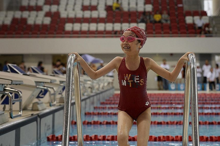 Eight-year-old Charlize Lim was all smiles leaving the swimming pool after winning a silver in the 50m freestyle in her age group. She also won gold in the 50m breaststroke.