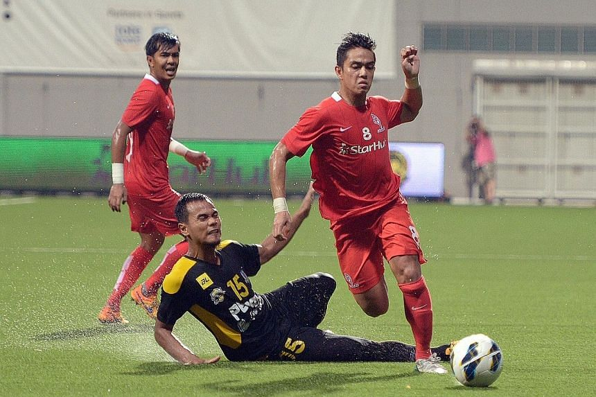 LionsXII's Hafiz Abu Sujad beating Perak's Mohd Idris Ahmad to the ball in their Malaysian Super League game. The Singapore team could be involved in the upcoming ASL.