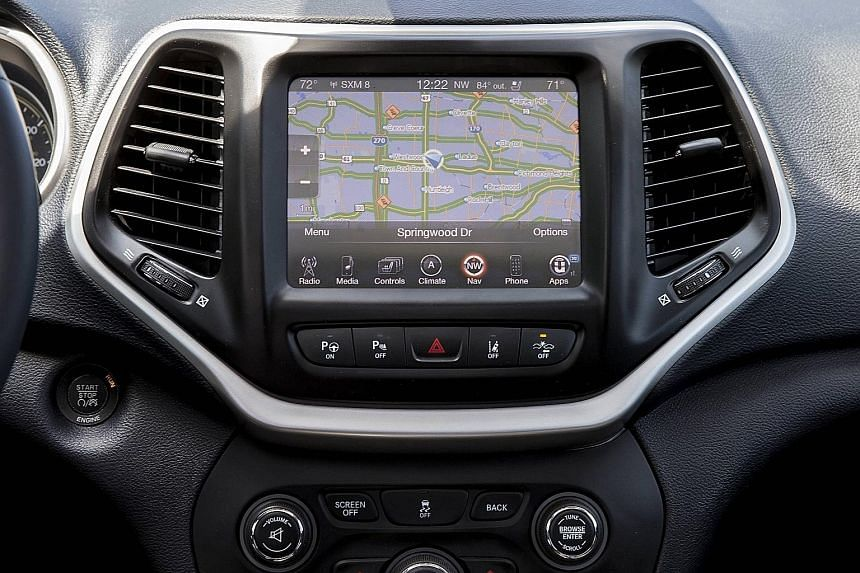 The console of a Jeep Cherokee, through which a pair of hackers were able to remotely control the engine, brakes and steering.