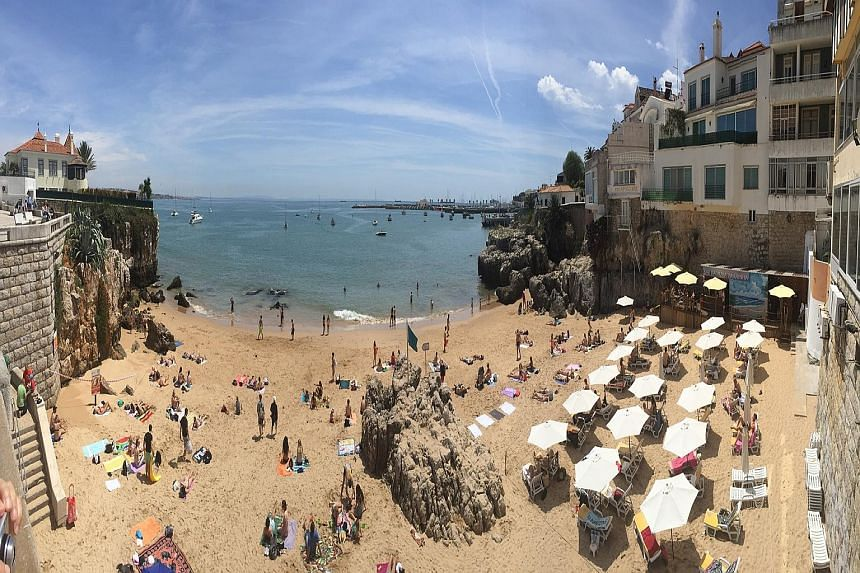Sunbathers at the Praia da Rainha (above), one of many beaches in the seaside town of Cascais; the Sao Bento train station (left) in Porto; and the River Douro (right) in Porto. The Roman temple of Evora (left) and the Church of the Most Holy Trinity
