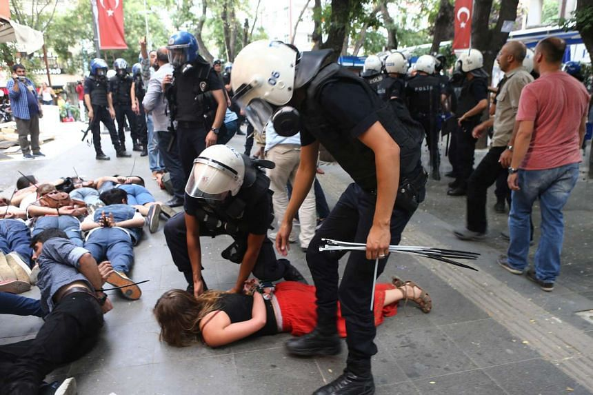 Demonstrators are detained by Turkish police officers during a protest in Ankara condemning a suicide bombing.