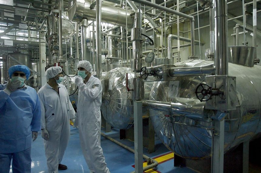 Technicians inspecting the site of the uranium conversion plant of Isfahan, central Iran, in Feburary 2007.