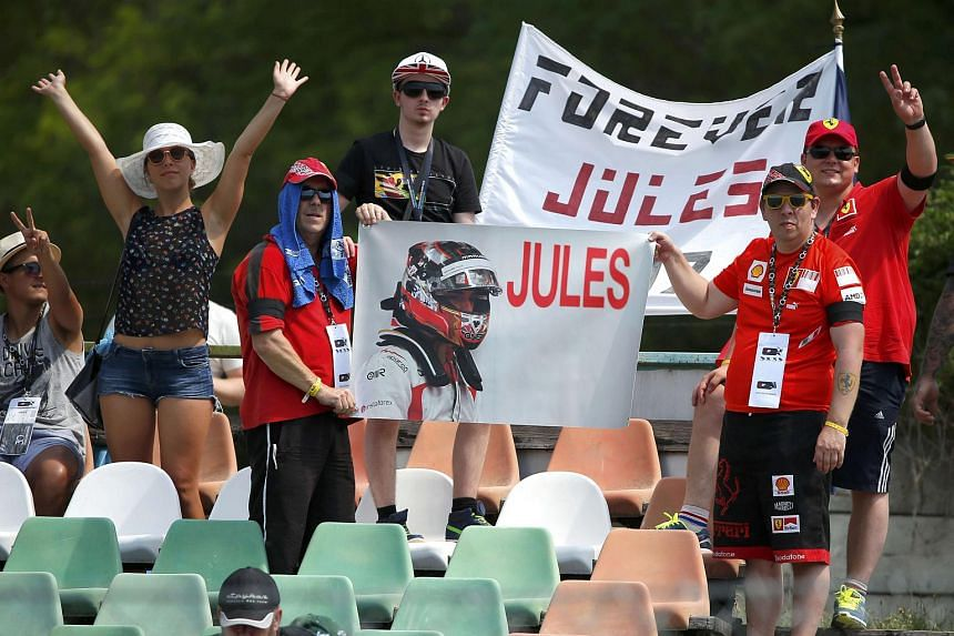 F1 supporters hold a banner in memoriam of former French Formula One driver Jules Bianchi during the first practice session of the Hungarian F1 Grand Prix at the Hungaroring circuit, near Budapest, Hungary on July 24, 2015.
