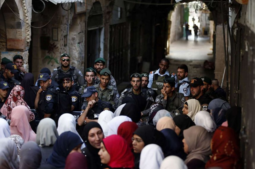 Israeli security forces block a road leading to the annexed east Jerusalem's Al-Aqsa mosque compound.