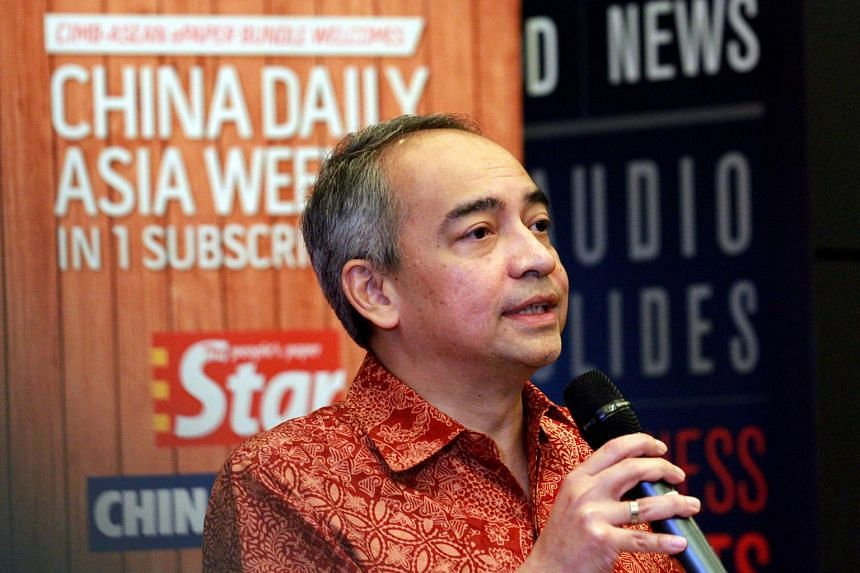 Malaysian banker Nazir Razak said he was standing up for freedom of expression, not defending anyone, after he condemned the Malaysian Home Ministry's suspension of business weekly The Edge.