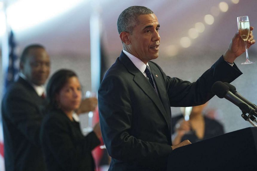 Obama raises a toast during a State Dinner hosted by Kenyan President Uhuru Kenyatta (left).