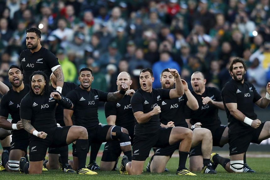 The New Zealand All Blacks performing the Haka before their Rugby Championship match against the South Africa Springboks at the Emirates Airline Park Stadium in Johannesburg on July 25, 2015.