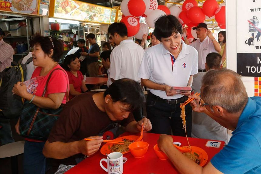 Potential candidate for Tanjong Pagar GRC Joan Pereira greeting residents and diners at Bukit Merah View market.