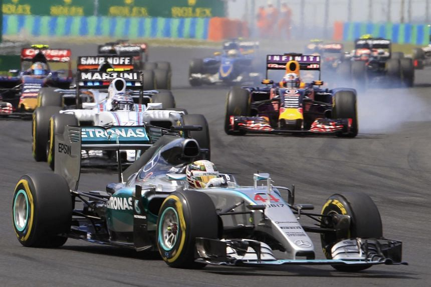 Mercedes Formula One driver Lewis Hamilton of Britain (front) drives during the Hungarian F1 Grand Prix at the Hungaroring circuit, near Budapest, Hungary on July 26, 2015.