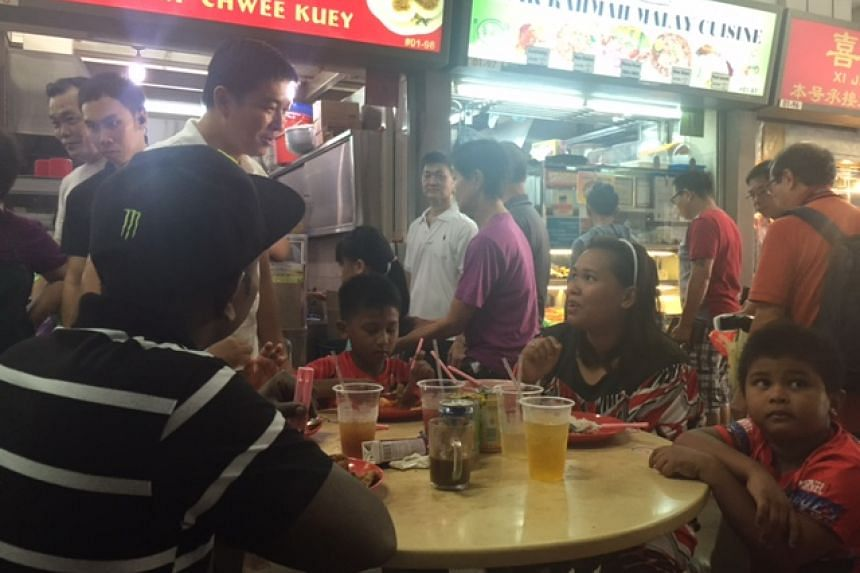 Tan Chuan-Jin greeting MacPherson residents having their breakfast at Circuit Road Market and Food Centre.