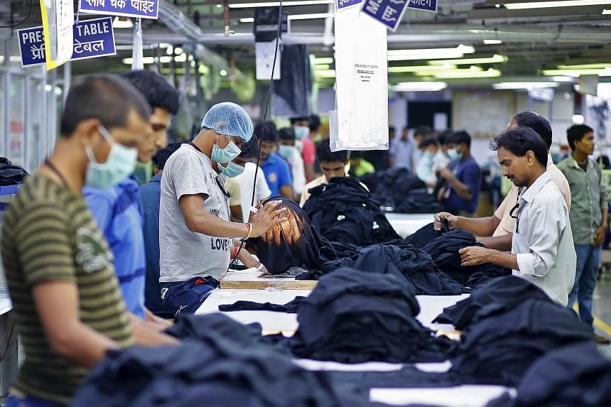 Employees work inside a garment factory of Orient Craft Ltd. at Gurgaon on the outskirts of New Delhi, India.