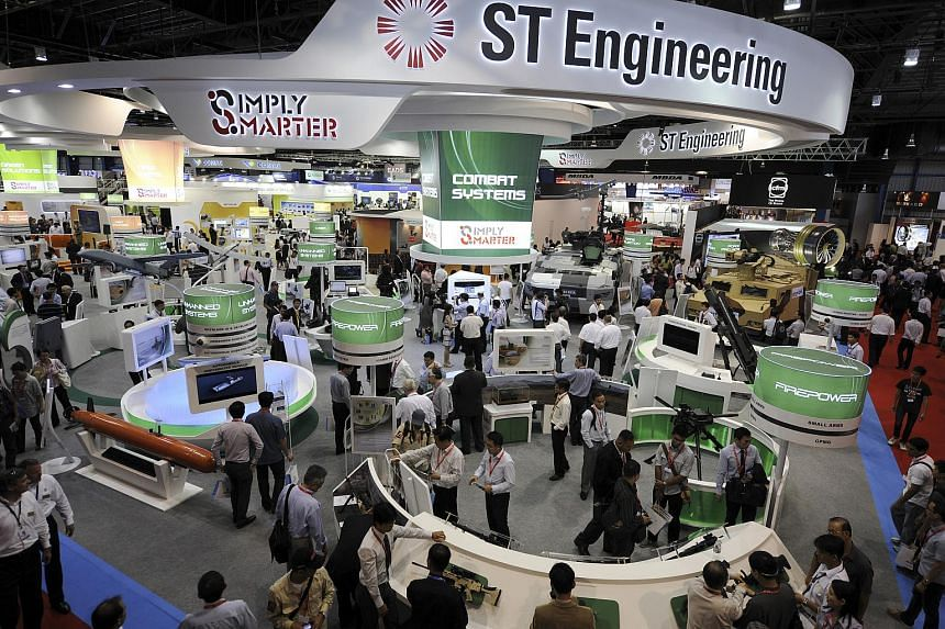 People walk through ST Engineering's booth at the Singapore Airshow.