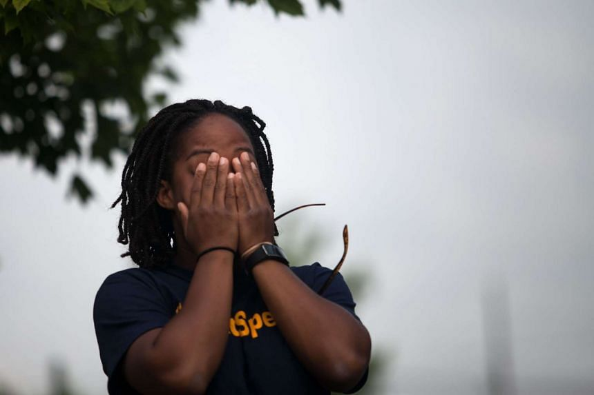 Jasmine Johnson, childhood friend of Sandra Bland, reacts to the sight of her casket.
