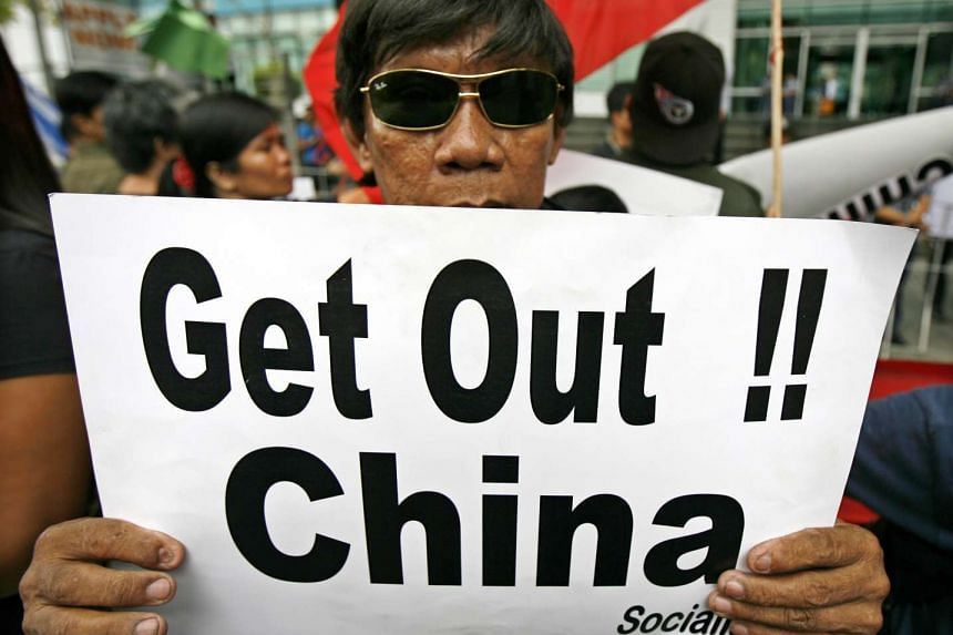 A Filipino protests China's South China Sea claims in Manila on July 24, 2015.