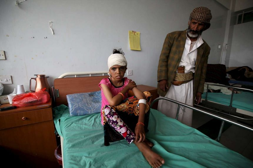 A child injured in a recent Saudi-led air strike sits on a hospital bed in Yemen's capital Sanaa.