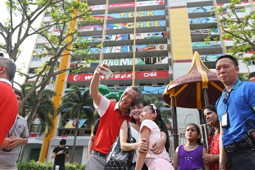 All is abuzz that Prime Minister Lee Hsien Loong, seen here taking a wefie with residents at the launch of PassionArts Festival in his Teck Ghee ward on July 18, will be introducing three new candidates in his six-member Ang Mo Kio GRC for the next genera