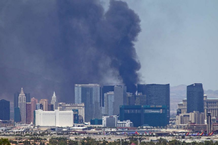 Smokes billows from a fire at the Cosmopolitan Hotel in Las Vegas.