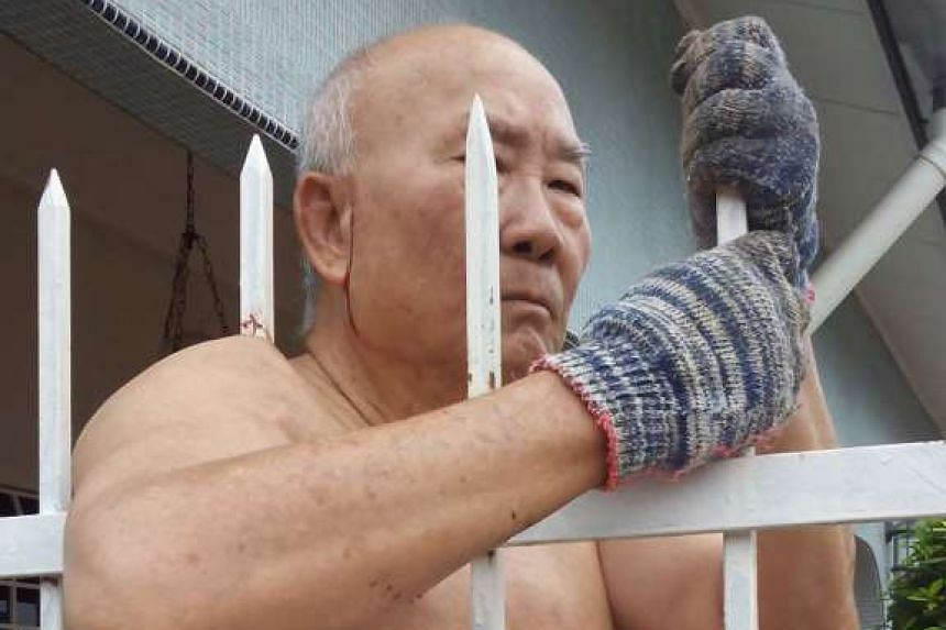 Ng Ah Eng whose armpit was pierced with an iron rod being helped by the Fire and Rescue Dept.