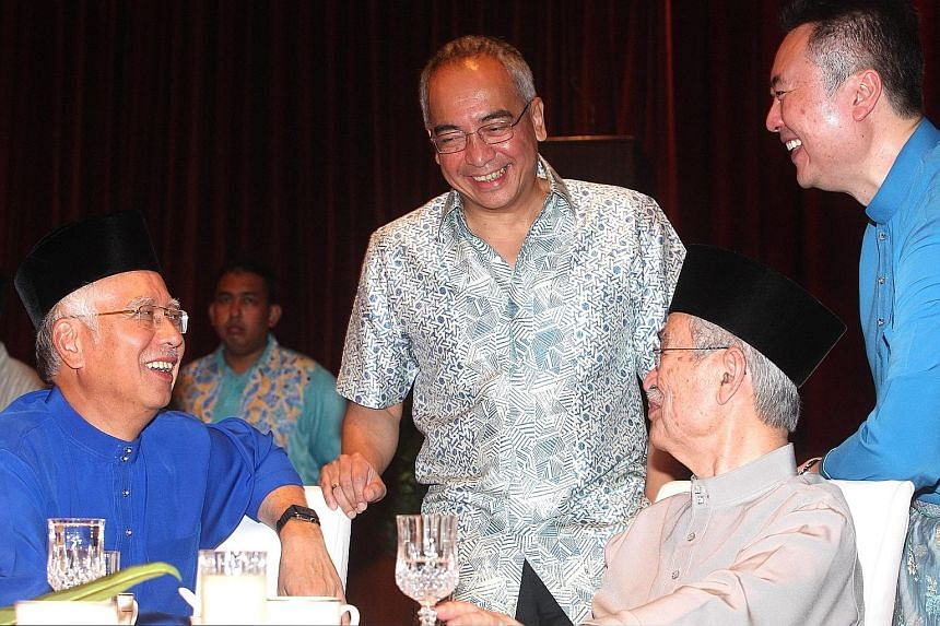 Prime Minister Najib Razak (far left) and former Malaysian leader Abdullah Ahmad Badawi sharing a light moment with Mr Nazir Razak (centre) and Tun Abdullah's son Kamaluddin Abdullah (left) during the former prime minister's Hari Raya open house in P