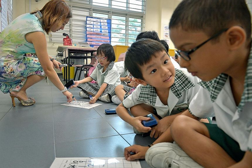 Teacher Valerie Tan conducting a maths lesson with a Primary 1 class in Northoaks Primary School. The school is one of three new primary schools that opened last year.
