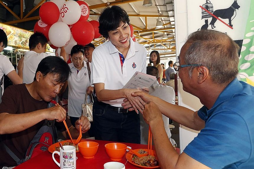 Ms Joan Pereira greeting a diner at Bukit Merah View Market and Food Centre yesterday morning during a walkabout when she was introduced as a new face in Tanjong Pagar GRC. She is no stranger to the area, having worked at Queenstown Community Centre