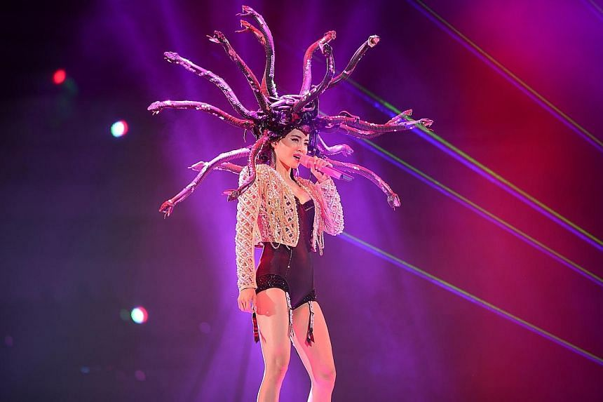 Jolin Tsai's concert proved a visual treat, with the superstar donning a Medusa headpiece (above) and having stage props such as a giant diamond- encrusted skull (left).