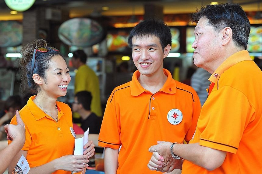 (From far left) Ms Kevryn Lim, 26, Mr Jan Chan, 25, and NSP president Sebastian Teo, 68, during a walkabout in Tampines West yesterday. NSP has contested in Tampines in every election except one, since 1988.