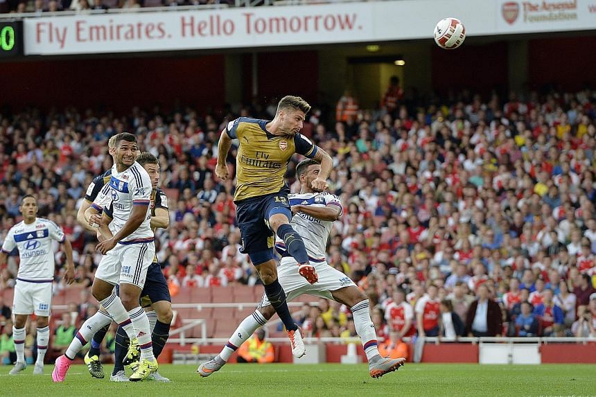 With Arsenal players such as Olivier Giroud (centre) rampant against Lyon, manager Arsene Wenger says he has enough firepower to launch a title assault.