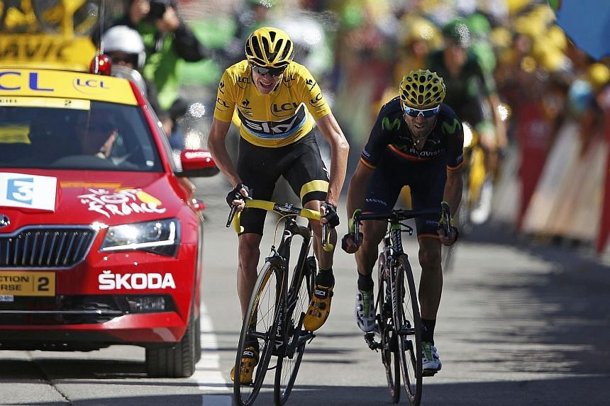 Team Sky rider Chris Froome, in the overall leader's yellow jersey, and Movistar rider Alejandro Valverde, sprinting to the finish line of the 110.5km 20th stage of the 102nd Tour de France from Modane to Alpe d'Huez in the French Alps. Froome says h