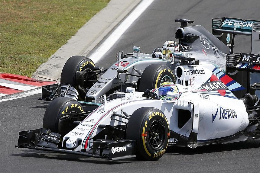 Mercedes' Lewis Hamilton (above) racing wheel-to-wheel with Williams' Felipe Massa. Hamilton, the reigning F1 world champion, admitted he made several bad decisions during the race.