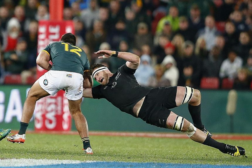 Kieran Read (right) exemplifies the fighting spirit of the All Blacks who withstood an onslaught from the Springboks to post a 27-20 victory.