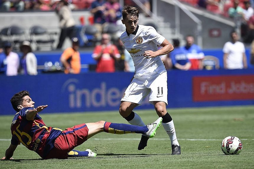 While fans of Man United will be happy with their 3-1 win against Barcelona, with Adnan Januzaj (right) among the scorers, Louis van Gaal says the real test will come when the EPL season begins.