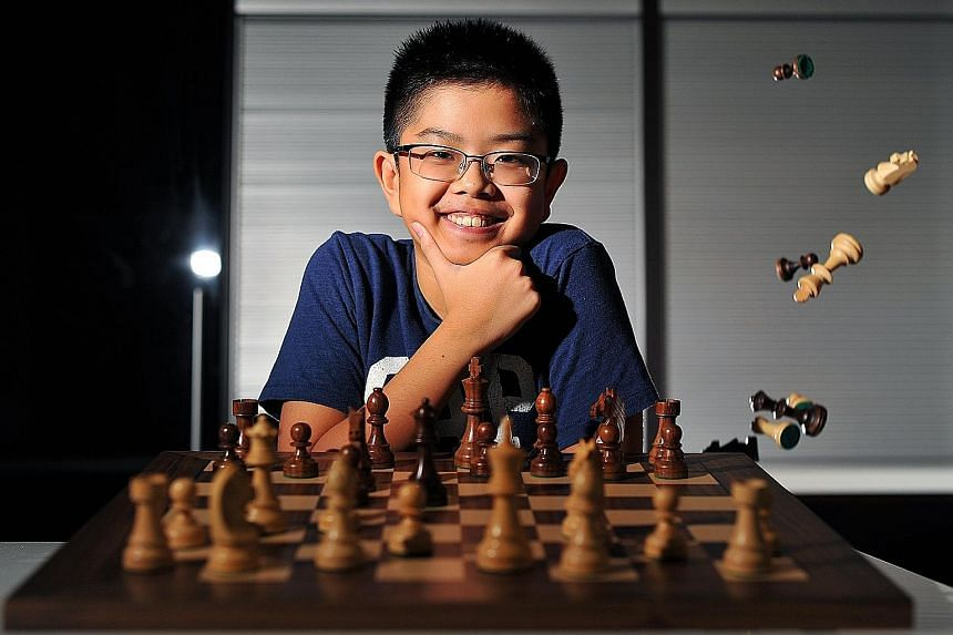Cyrus Low (above), 13, is Singapore's top under-14 chess player, the ninth best in Asia and the 38th in the world in this age group. To show his commitment to the game, Cyrus gave most of his toys to his younger brother Darius (below, left), with who
