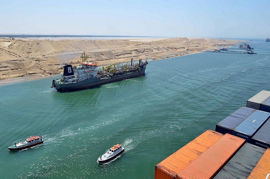 Vessels navigating the New Suez Canal in a test-run on Saturday. The waterway will be officially opened on Aug 6.
