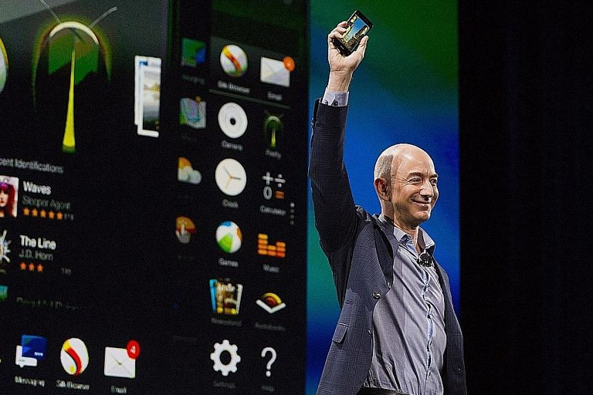 Amazon chief executive Jeff Bezos unveiling the Fire Phone in Seattle last year. For the week, Amazon shares rose 9.6 per cent.