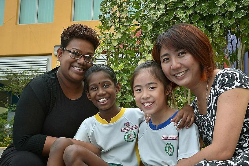 MADAM RACHEL KOW, with daughter Janelle. Her views are shared by Madam Nahrahyeenee Tamil Selvan, who is pleased that the school is helping her child, Tharine, develop self-confidence