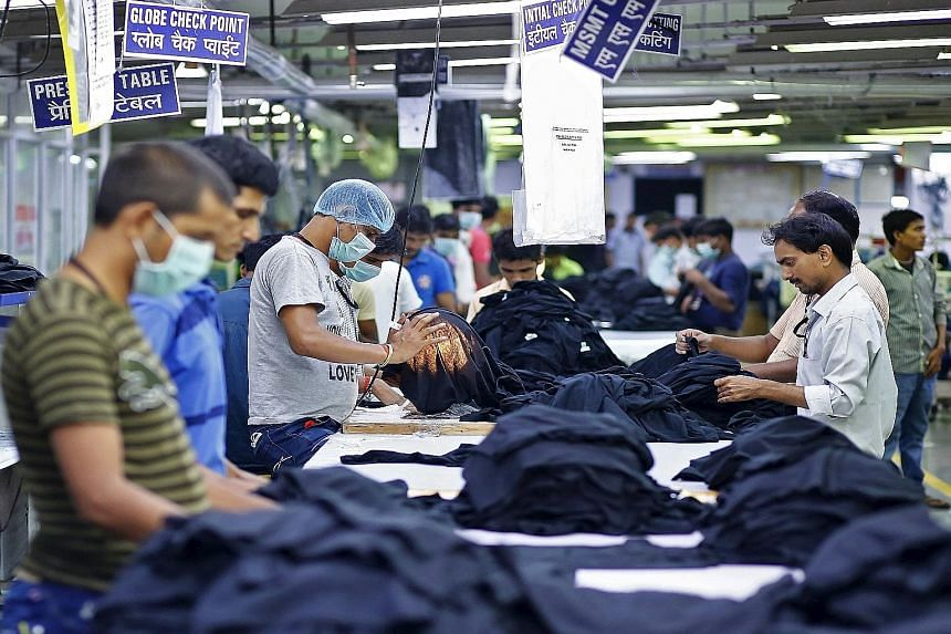 Employees at the Orient Craft garment factory in Gurgaon, on the outskirts of New Delhi, India. The company, which has suffered three riots in three years, fears the changes will create as many problems as they solve.