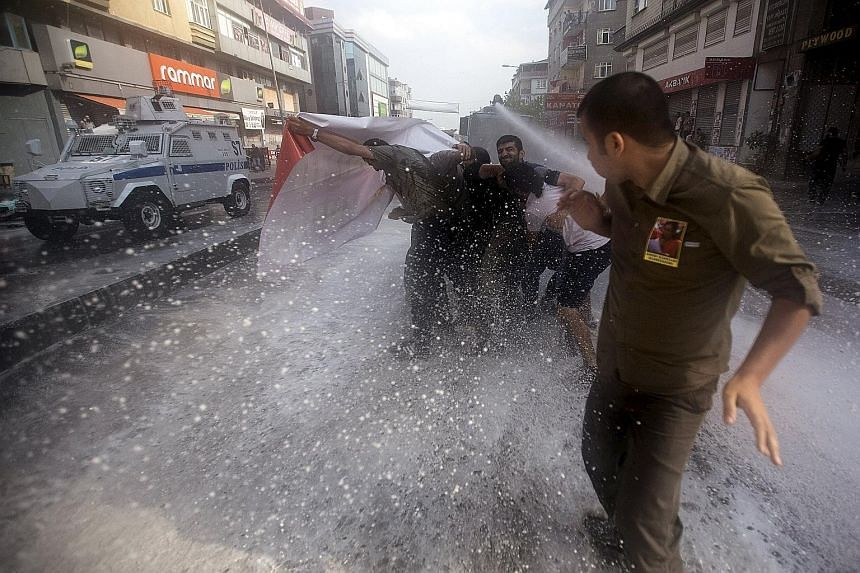 Police in Istanbul dispersing demonstrators at the funeral on Saturday of Ms Gunay Ozarslan, a member of the far-left People's Front who, according to local media, was killed by police during a security operation.