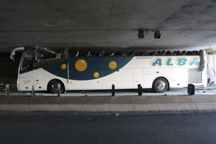 The Spanish tour bus is seen inside the tunnel with its roof sheared off.